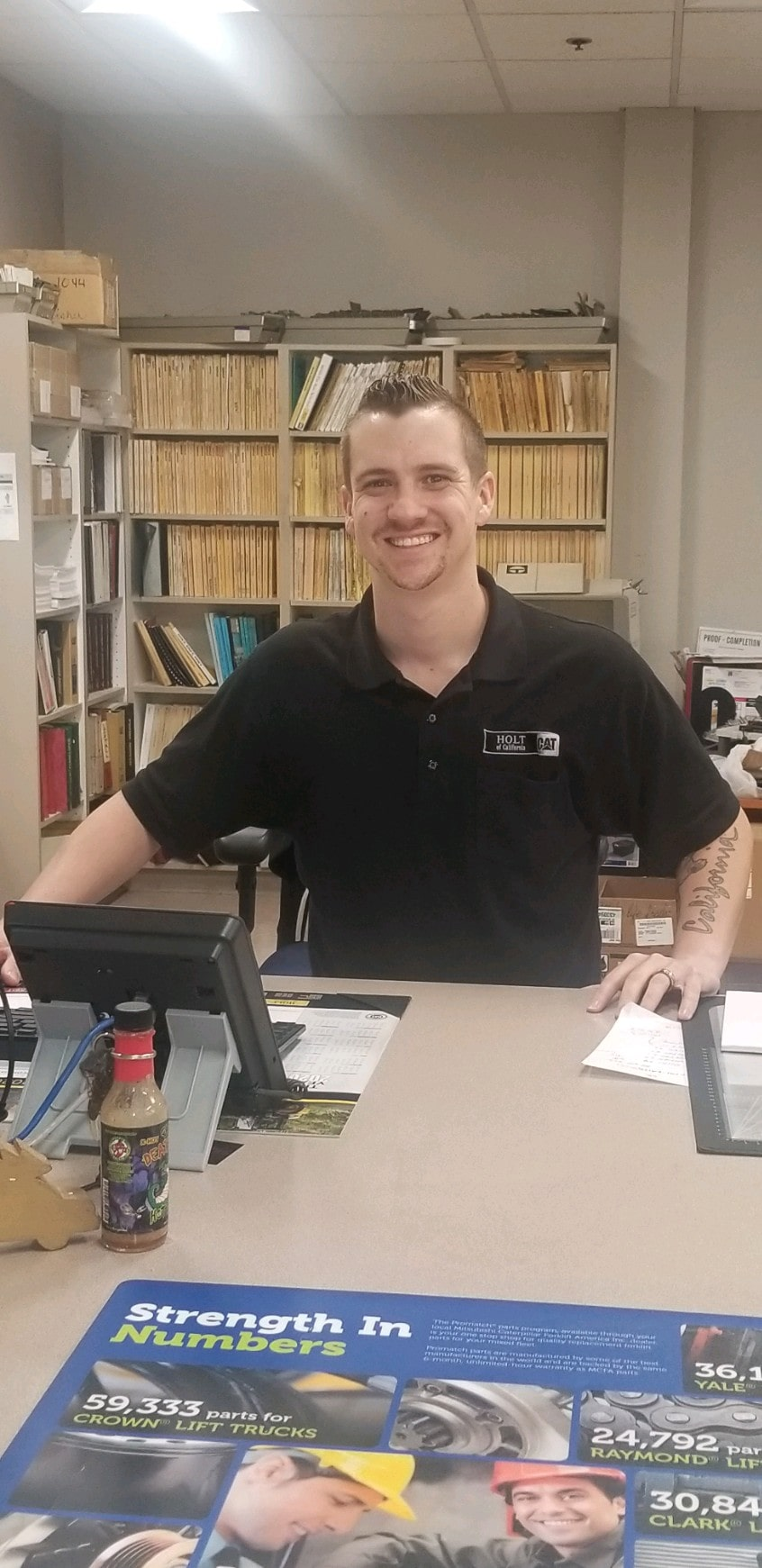Sam Post smiling behind a computer