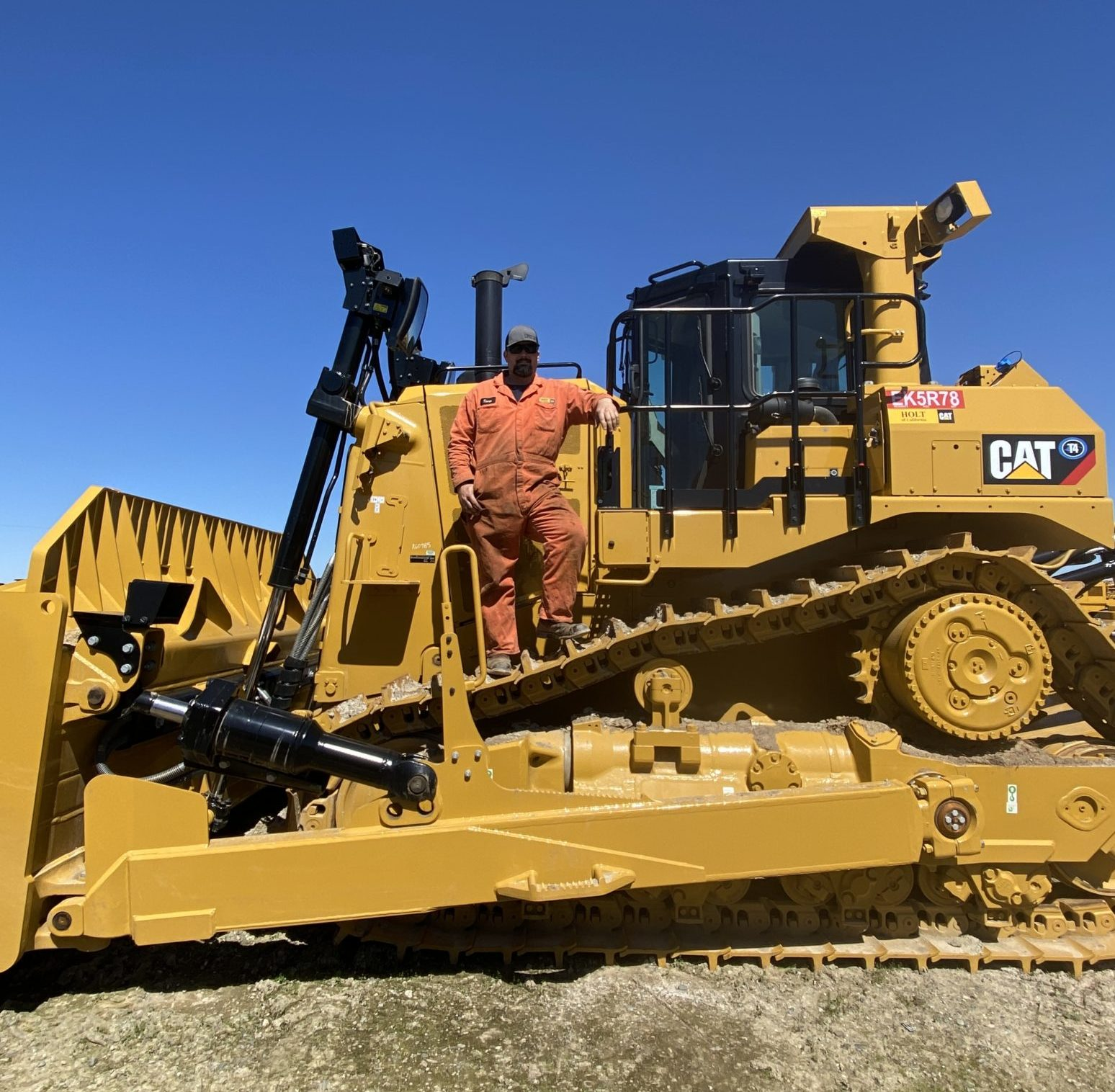 Thomas Mitchell posing on a piece of heavy machinery